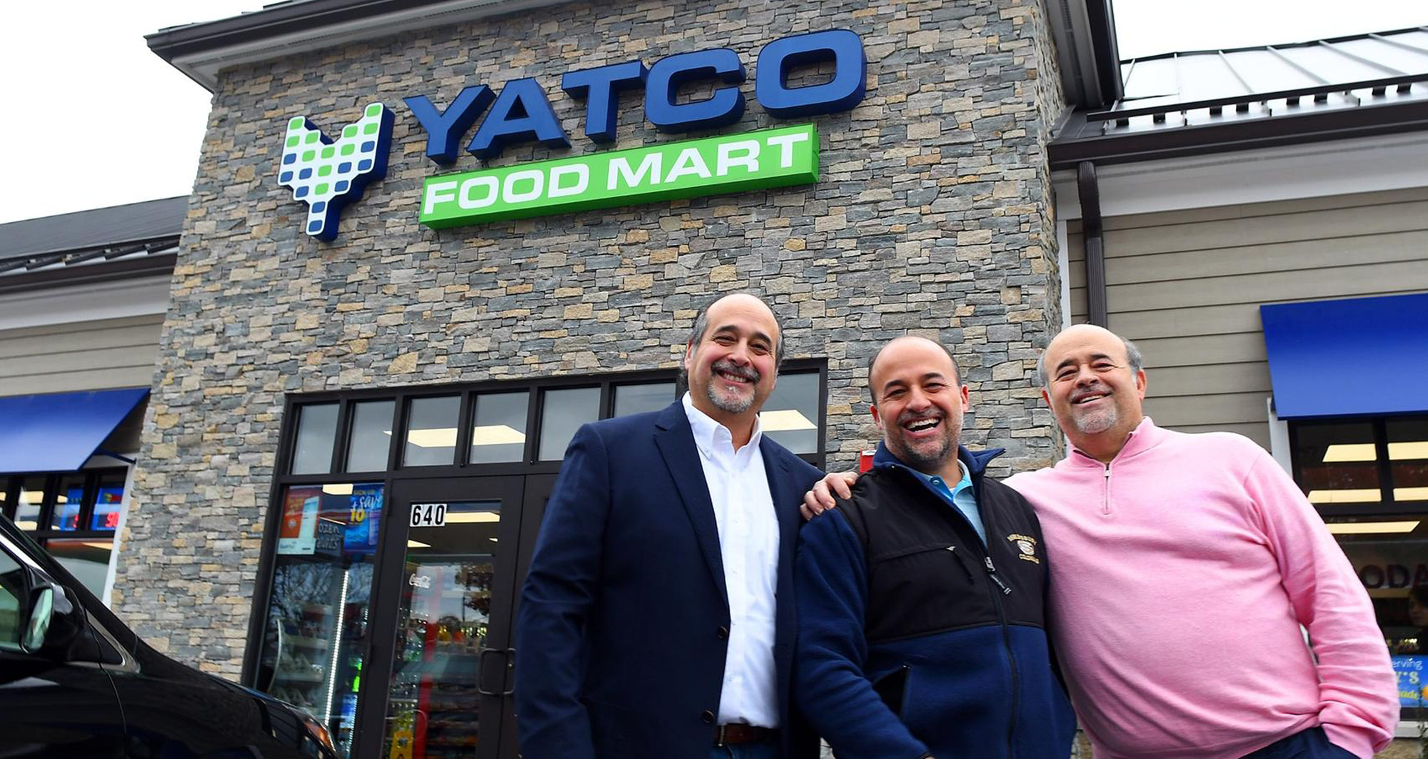 Yatco food mart owners in front of Yatco Food Mart store, Massachusetts food mart, Massachusetts convenience store